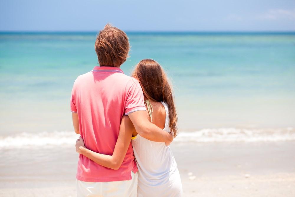 young beautiful couple on tropical bali beach.honeymoon