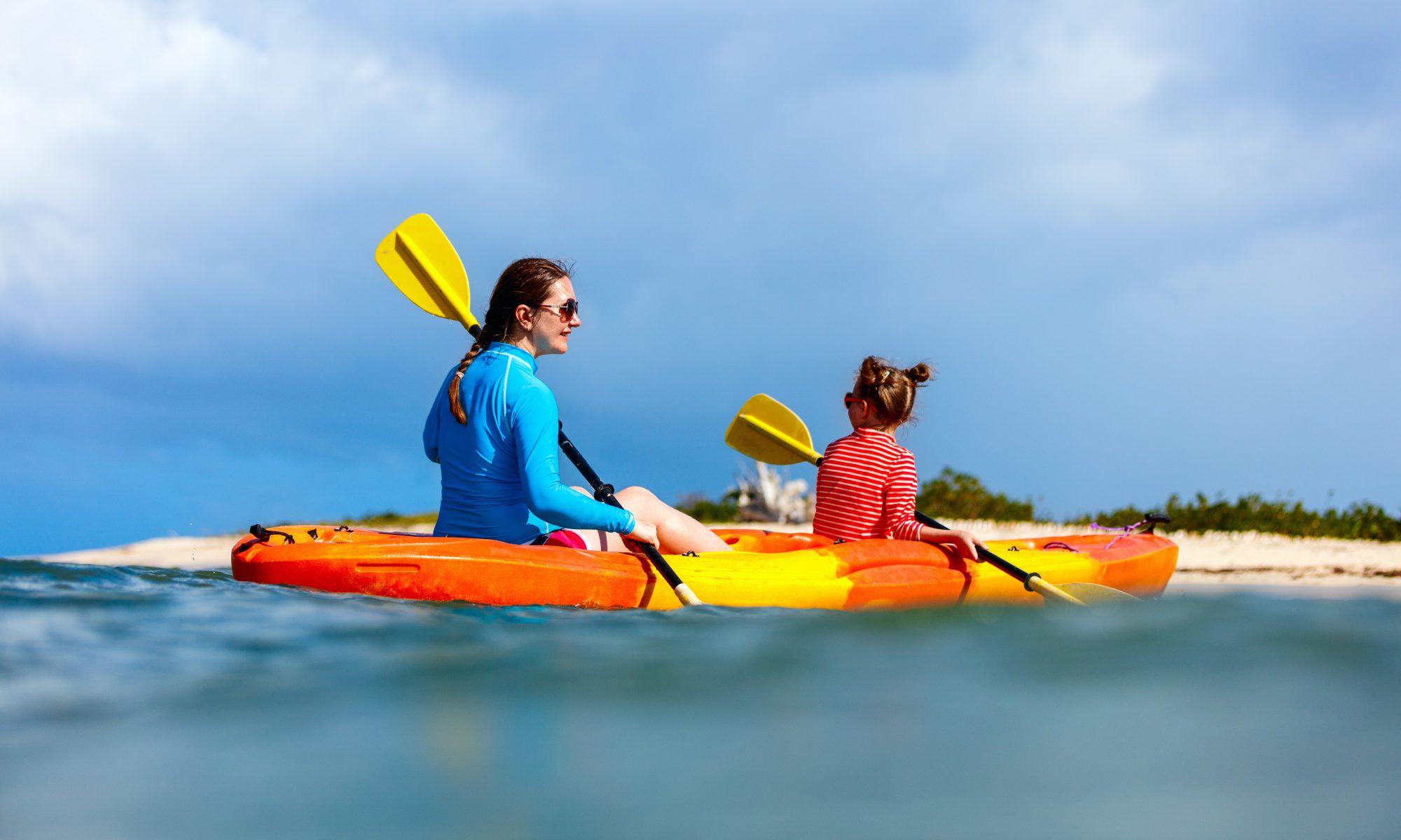 Family kayaking at tropical ocean
