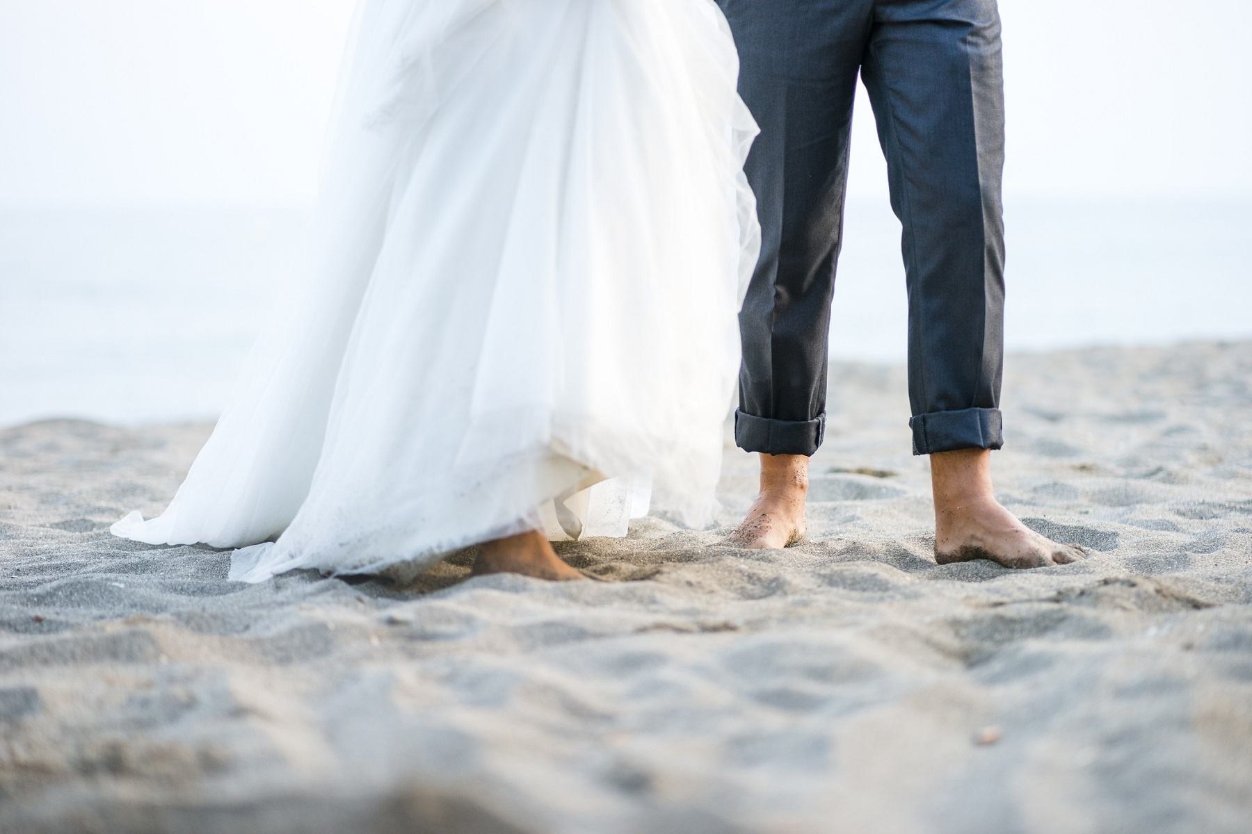 Barefooted bride and groom on the beach